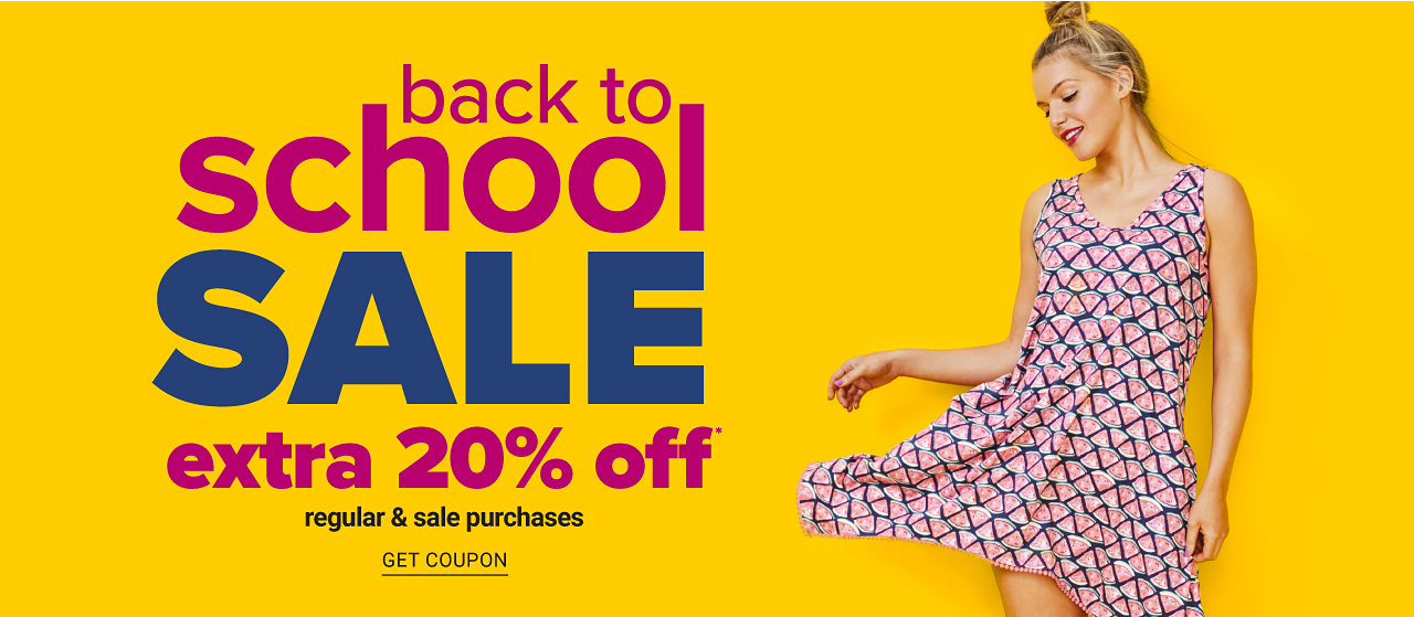 A young woman wearing a pink & black patterned print sleeveless dress. Back to School Sale. Extra 20% off regular & sale purchases. Get coupon.