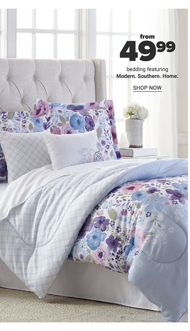 A bed made with a multi colored floral print comforter & matching pillows. From $9.99 bedding featuring Modern Southern Home. Shop now.