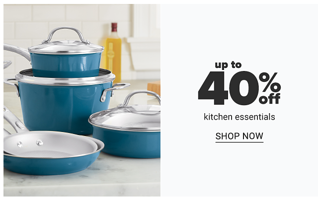 An assortment of blue pots & pans with clear lids. Up to 40% off kitchen essentials. Shop now.