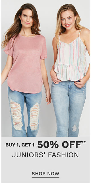 A young woman wearing a dusty rose short sleeved top & distressed blue jeans standing next to a woman wearing a multi colored vertical striped tank & distressed blue jeans. Buy 1, Get 1 50% off juniors' fashion. Free or discounted items must be of equal or lesser value. Shop now.
