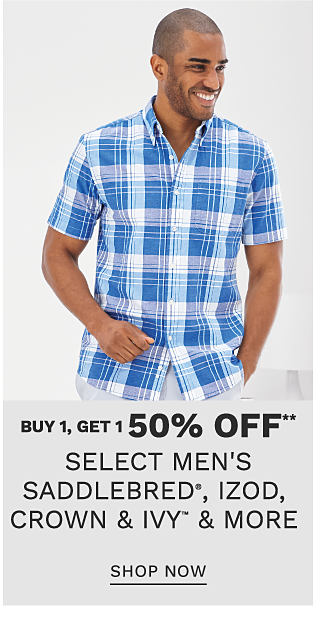 A man wearing a blue & white plaid short sleeved button front shirt & white shorts. Buy 1, Get 1 75% off select men's Saddlebred, IZOD, Crown & Ivy & more. Free or discounted items must be of equal or lesser value. Shop now.