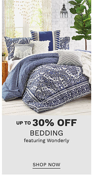 A bed made with a reversible navy & white patterned print comforter & matching pillows. Up to 30% off bedding featuring Wonderly. Shop now.