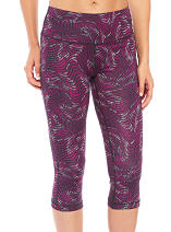 A woman wearing purple, black and white yoga pants. Shop activewear.