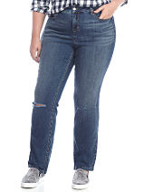 A woman wearing distressed blue jeans. Shop jeans.