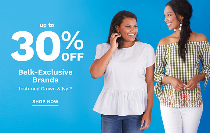 A woman wearing a white top and jeans standing next to a woman wearing a white and olive print cold shoulder top and white pants. Up to 30% off Belk-Exclusive Brands featuring Crown & Ivy. Shop now.