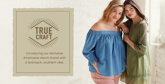 A young woman wearing a powder blue cold-shoulder top and rose pants, standing next to a young woman wearing a green patterned dress. New juniors' plus styles from True Craft. Shop now.