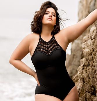 A woman wearing a black one-piece swimsuit. Shop swimwear.