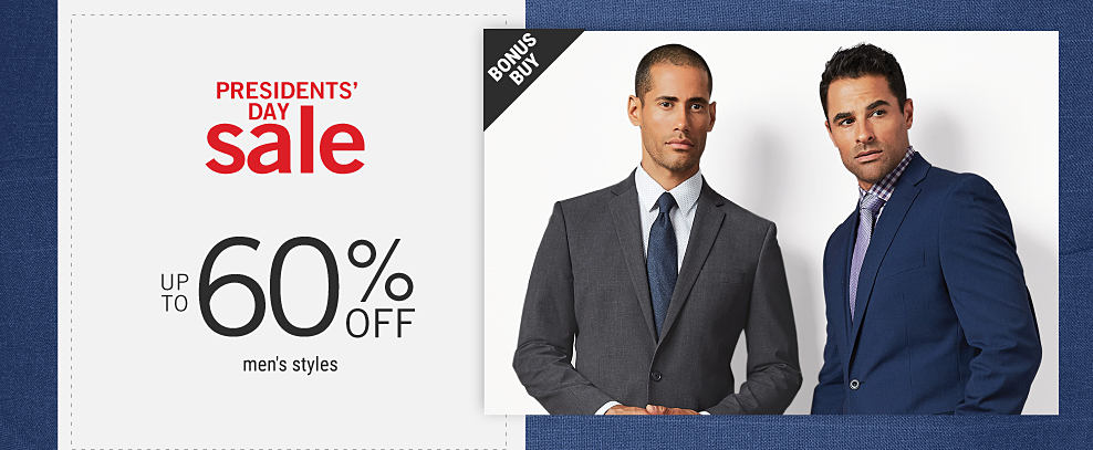A man wearing a dark gray suit, a white dress shirt & a navy tie standing next to a man wearing a navy suit, a blue & white check dress shirt & a purple tie. Presidents Day Sale. Bonus Buy. Up to 60% off men's styles.