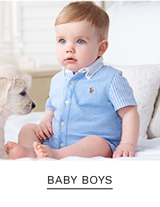 A baby boy wearing a blue short sleeve button front shirt. Shop baby boys.
