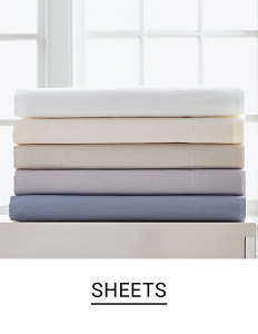 A stack of folded dheets in a variety of colors. Shop sheets.