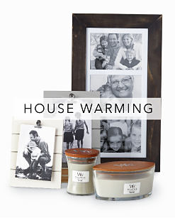 An assortment of picture frames & candles. House Warming. Shop now.