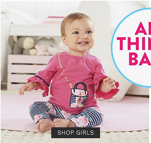 A baby girl wearing a pink long sleeved top with a navy & white handbag front graphic & navy & white horizontal striped bottoms with a pink floral print. Baby Sale Bonus Buys. Up to 50% off. Shop girls.