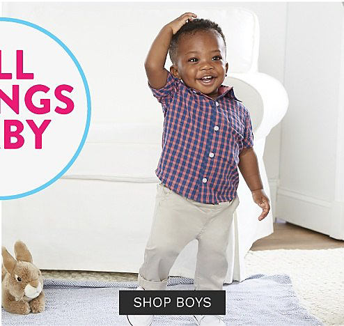 A baby boy wearing a red and blue plaid short sleeved button front shirt, white pants & white sneakers. Baby Sale Bonus Buys. Up to 50% off. Shop boys