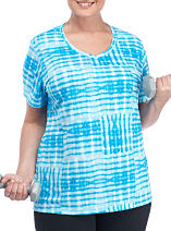 A woman wearing a blue and white printed top. Shop activewear.