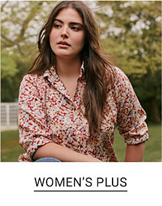 A woman in a red and white top. Shop women's plus.