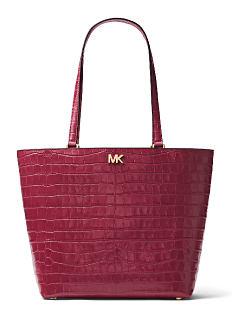 A burgundy leather croc tote. Shop MICHAEL Michael Kors.
