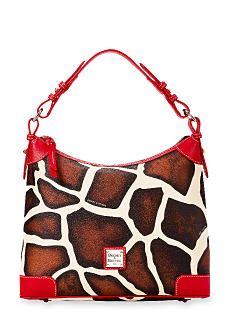 A brown, white & red leather cowhide print crossbody handbag. Shop Dooney & Bourke.