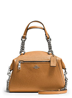 A light brown leather handbag with silver chain handle detail. Shop Coach.