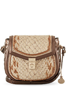 A brown leather crossbody bag with gold hardware. Shop crossbodies.
