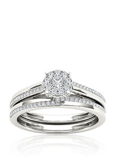 A sterling silver ring with an ornate diamond centerpiece and diamonds all along the band. Shop fine jewelry rings.