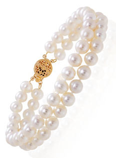 A 2-row pearl bracelet with a gold clasp. Shop fine jewelry bracelets.