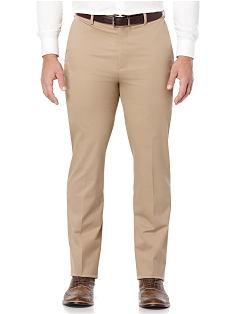 A man wearing a white button front shirt and khaki pants. Shop pants