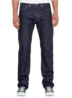 A man wearing a white T-shirt & blue jeans. Shop jeans.