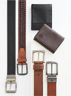 An assortment of men's wallets & belts. Shop accessories.