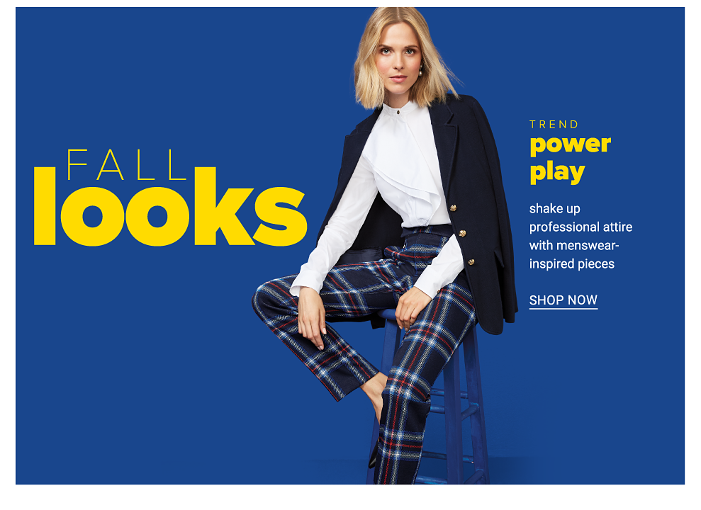 A woman wearing a black blazer over a white blouse & blue & whiite plaid pants. Fall Looks. Trend Power Play. Shake up professional attire with menswear inspired pieces. Shop now.