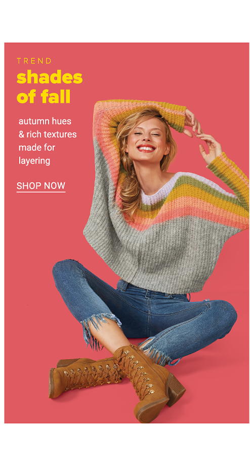 A woman wearing a multi colored striped sweater, blue jeans & brown leather boots. Trend. Shades of Fall. Autumn hues & rich textures made for layering. Shop now.