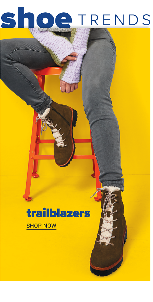 Shoe Trends. A woman wearing a white sweater, gray jeans & brown suede fleece lined lace up boots. Trailblazers. Shop now.