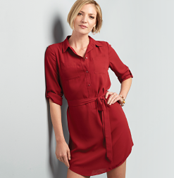 A woman in a red collared dress with a tie at the waist. The dress shop.