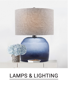 A blue table lamp with a beige lampshade. Shop lamps & lighting.