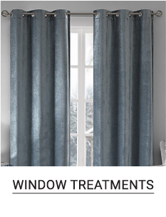 A window covered with gray curtains. Shop window treatments.