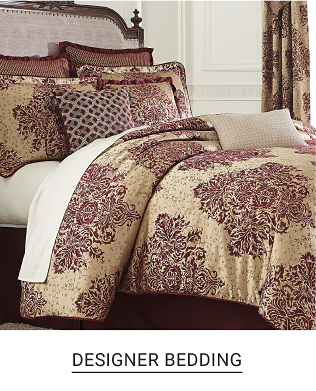 A bed made up in a beige comforter with matching pillows. Shop now
