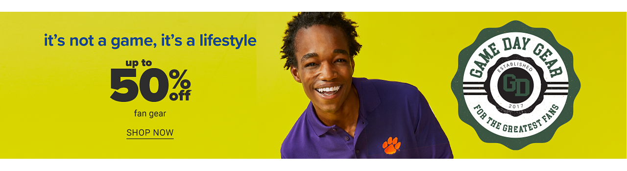 A young man wearing a purple polo with an orange Clemson Tigers left chest logo. Game Day Gear for the greatest fans. It's not a game, it's a lifestyle. Doorbuster. Up to 50% off fan gear. Shop now.