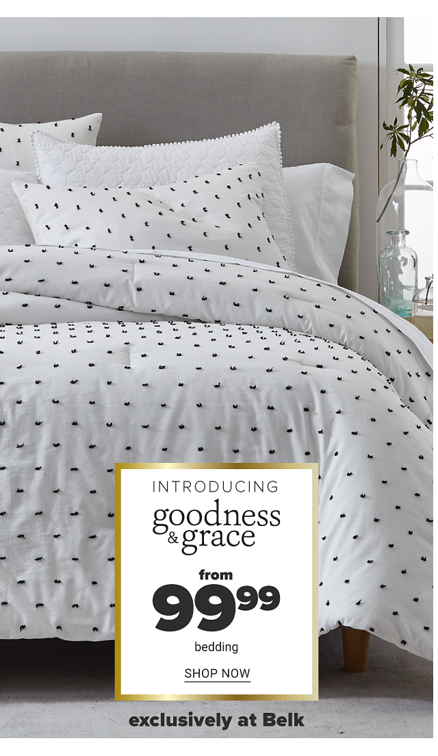 A bed made with a white & navy patterned print comforter & matching pillows. Introducing Goodness & Grace. From $99.99 bedding. Shop now.