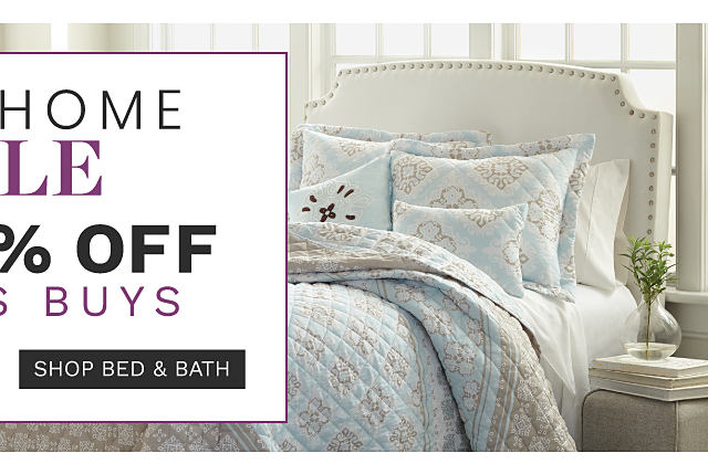 A dark purple & white patterned print 5 piece luggage set. A bed made with a beige & white reversible patterned print quilt & matching pillows. Fall Home Sale Bonus Buys. Shop bed & bath.