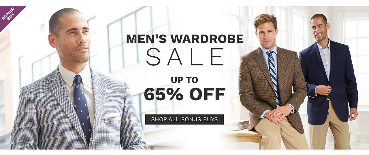 A man wearing a navy, white & brown plaid sport coat, a white dress shirt & a navy tie with a brown & white patterned print. A man wearing a black, white & brown plaid sport coat, a white dress shirt & a navy tie with a white & brown patterned print. A man wearing a brown sport coat, a light blue dress shirt, a navy, light blue & white diagonal striped tie & beige pants sitting next to a man wearing a navy sport coat, a light blue dress shirt & beige pants. Men's Wardrobe Sale. Bonus Buy. Up to 65% off. Shop all Bonus Buys.
