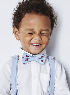 A toddler boy wearing a white button-front dress shirt & a powder & red bow tie, Shop toddler boys.