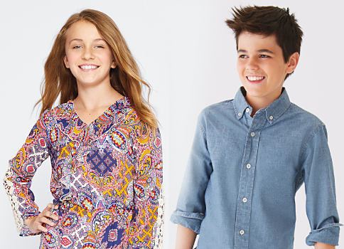 A girl wearing a multi-colored print top standing next to a boy wearing a light blue button-front shirt. Shop J Khaki.