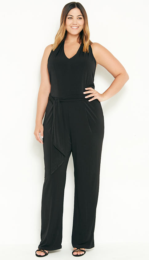 A woman wearing a black jump suit. Fall Fashion Preview featuring Michael Kors. Shop now.