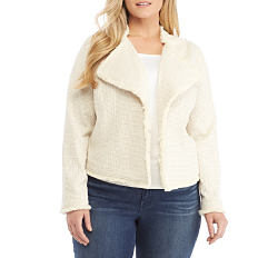 A woman wearing a cream colored open front coat over a white top & blue jeans. Shop coats.