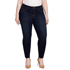 A woman wearing a white short sleeved top, blue jeans & brown heels. Shop jeans.