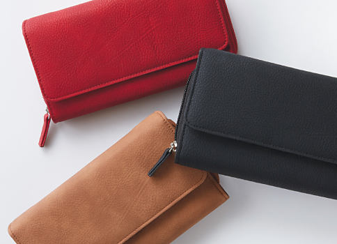 An assortment of women's wallets in a variety of colors. Shop accessories.