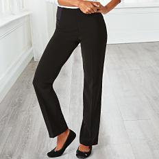 A woman wearing a white top, black pants & black heels. Shop pants.