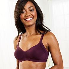 A woman wearing a burgundy bra. Shop intimates.