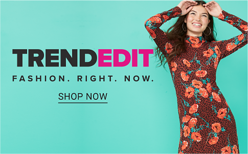 A young woman wearing a leopard print and floral dress with long sleeves. Trend edit. Fashion. Right. Now. Shop now.