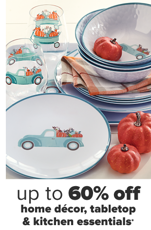 A fall themed table set with matching dinnerware featuring a truck full of pumpkins. Up to 60% off home decor, tabletop and kitchen essentials.