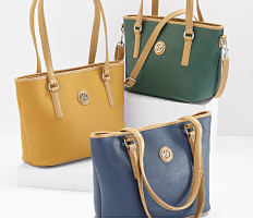 An assortment of leather totes in a variety of colors. Shop handbags.